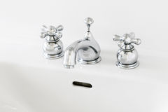 Sink faucet. Two handle sink faucet, white sink, private residence Stock Image