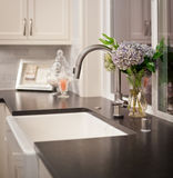 Sink with flower arrangement in new home Stock Photography