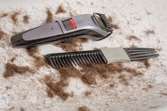 Sink full of hair and dirty comb, trimmer. Sink full of hair and dirty comb, trimmer royalty free stock image
