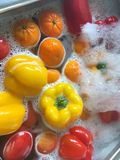 Fruit and vegetables being washed. stock images