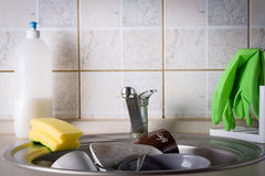 Sink full of washing dishes. Filled with dish soap water Royalty Free Stock Photography