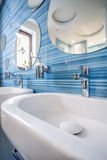 Sink in fun blue bathroom. Simple sink in fun blue bathroom with bubble shaped mirrors Royalty Free Stock Photography