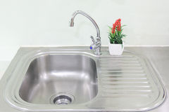 The sink and glass, stainless steel and decorated with fake tree. Interior Royalty Free Stock Photo