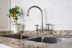 Sink and mixer faucet in kitchen Royalty Free Stock Images