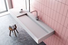 Sink in a pink bathroom interior, top view. Modern sink in a pink tiled bathroom interior with a narrow vertical mirror and toiletry. A top view. 3d rendering stock illustration