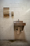 Sink. Public restroom sink with soap dispenser and paper towel holder royalty free stock photo