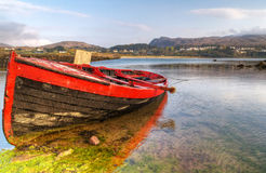 Sink red boat. At Mulranny bay in Irish Co. Mayo - HDR royalty free stock image