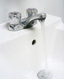 Sink with running water. Royalty Free Stock Photos