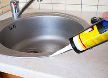 Sink and silicone sealant Royalty Free Stock Images