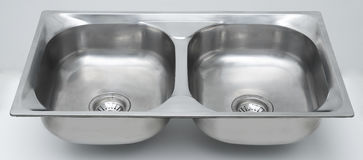 Sink. A stainless steel double sink Stock Photos