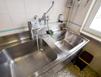 Sink stainless steel industrial kitchen with open tap Stock Image