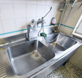 Sink stainless steel industrial kitchen with tap Stock Image