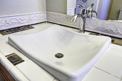 Sink with steel faucet. Close up view Royalty Free Stock Photos