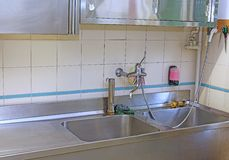 Sink a steel industrial kitchen in the school canteen Royalty Free Stock Images