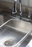 Sink and Strainer. Shiny chrome kitchen sink with strainer Royalty Free Stock Photography