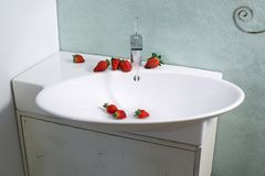 Sink and strawberries Stock Photo