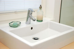 Sink tap and basin. White and modern sin tap and basin Royalty Free Stock Images