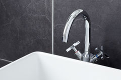 Sink tap in contemporary bathroom Stock Photo