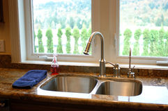Sink with a view. Modern American House interior Royalty Free Stock Photography