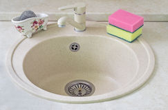 Sink for ware from metal ceramics and a sponge for washing. Stock Image