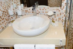 Sink, wash basin and other bathroom amenities. In the bathroom royalty free stock images