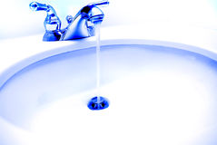 Sink with Water Running royalty free stock images