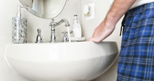 Sink with Water Running From Faucet Stock Photo