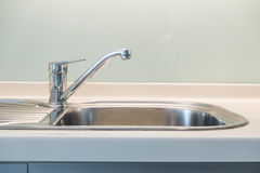 Sink and water tab. Faucet Sink and water tab decoration in kitchen room interior royalty free stock photos