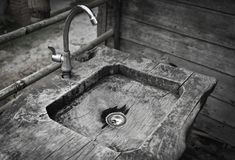 Sink water With wood. Sink water With old wood Image Monochrome royalty free stock image