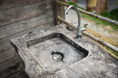 Sink water With wood. Sink water With old wood Image Monochrome stock image
