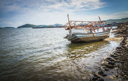 The sinked boat with fisherman village3 Stock Images