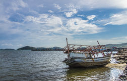 The sinked boat with fisherman village2 Royalty Free Stock Photography