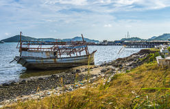 The sinked boat with fisherman village1 Royalty Free Stock Image