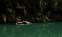 Sinked boat in a river. With tropical colors Stock Photo