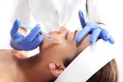 Sinkendes Augenlid, Einspritzung von botox Stockbilder