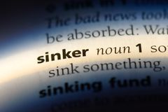 Sinker. Word in a dictionary.  concept stock photography