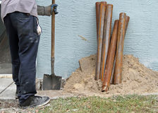Sinkhole Repair. Workers repairing a house that has a sinkhole Royalty Free Stock Photos
