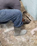 Sinkhole Repair. Workers repairing a house that has a sinkhole Stock Photography