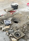 The sinkhole  of a yard. A bricklayer arranging the drainage hole of a yard in house Stock Images