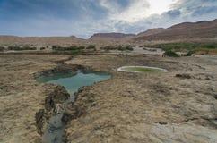 Sinkholes in the desert. Sinkholes near the Dead Sea in Israel Stock Photos