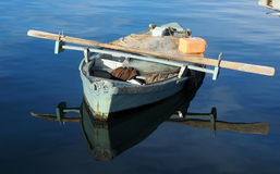 Sinking boat Stock Images