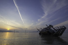 Sinking boat, view at sunrise Royalty Free Stock Photography