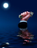 Sinking businessman. Businessman sinks with cash in his hands Royalty Free Stock Photo
