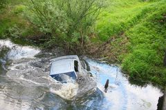 Sinking car. In river Royalty Free Stock Images