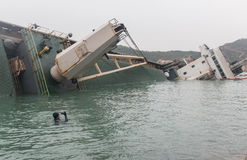 Sinking cargo ship in Hong Kong Stock Photos