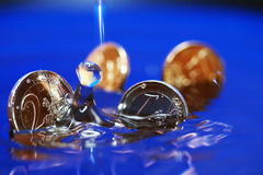 Sinking Coins Stock Photography