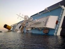 Sinking cruise ship Costa Concordia royalty free stock photo