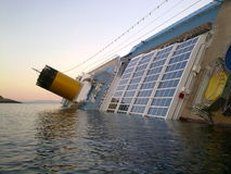 Sinking cruise ship Costa Concordia royalty free stock image