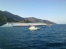 Sinking cruise ship Costa Concordia Royalty Free Stock Photos