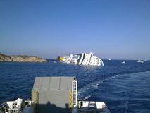 Sinking cruise ship Costa Concordia royalty free stock photos